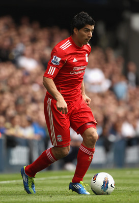 LONDON, ENGLAND - SEPTEMBER 18:  Luis Suarez of Liverpool with the ball during the Barclays Premier League match between Tottenham Hotspur and Liverpool at White Hart Lane on September 18, 2011 in London, England.  (Photo by Clive Rose/Getty Images)