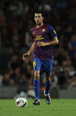 BARCELONA, SPAIN - AUGUST 29:  Sergio Busquets of FC Barcelona runs with the ball during the La Liga match between FC Barcelona and Villarreal CF at Camp Nou on August 29, 2011 in Barcelona, Spain.  (Photo by David Ramos/Getty Images)