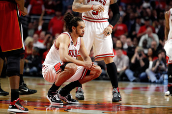 CHICAGO, IL - MAY 18:  Joakim Noah #13 of the Chicago Bulls gets warmed up to play against the Miami Heat in Game Two of the Eastern Conference Finals during the 2011 NBA Playoffs on May 18, 2011 at the United Center in Chicago, Illinois. The Heat won 85-