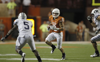 AUSTIN, TX - SEPTEMBER 10:  Wide receiver Jaxon Shipley #8 of the Texas Longhorns avoids defensive back Joe Sampson #5 of the BYU Cougars in the fourth quarter on September 10, 2011 at Darrell K. Royal-Texas Memorial Stadium in Austin, Texas.  Texas defea
