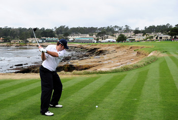 PEBBLE BEACH, CA - FEBRUARY 10:  Tony Romo plays a tee shot during the 3M Celebrity Challenge at the AT&T Pebble Beach National Pro-Am at Pebble Beach Golf Links on February 10, 2010 in Pebble Beach, California.  (Photo by Stuart Franklin/Getty Images)