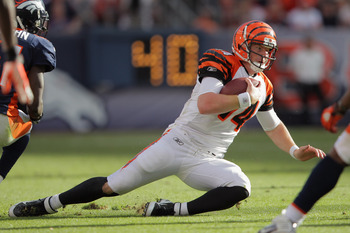 DENVER, CO - SEPTEMBER 18:  Quarterback Andy Dalton #14 of the Cincinnati Bengals scrambles with the ball against the Denver Broncos at Sports Authority Field at Mile High on September 18, 2011 in Denver, Colorado. The Broncos defeated the Bengals 24-22.