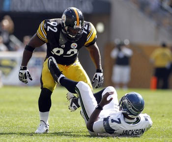 PITTSBURGH, PA - SEPTEMBER 18:   James Harrison #92 of the Pittsburgh Steelers reacts to sacking Tarvaris Jackson #7 of the Seattle Seahawks during the game on September 18, 2011 at Heinz Field in Pittsburgh, Pennsylvania.  The Steelers defeated the Seaha