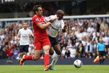 LONDON, ENGLAND - SEPTEMBER 18:  Jose Enrique of Liverpool attempts to challenge Jermain Defoe of Tottenham Hotspur for the ball during the Barclays Premier League match between Tottenham Hotspur and Liverpool at White Hart Lane on September 18, 2011 in L