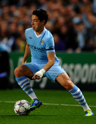 MANCHESTER, ENGLAND - SEPTEMBER 14:  Samir Nasri of Manchester City in action during the UEFA Champions League Group A match between Manchester City and SSC Napoli at the Etihad Stadium on September 14, 2011 in Manchester, England.  (Photo by Laurence Gri