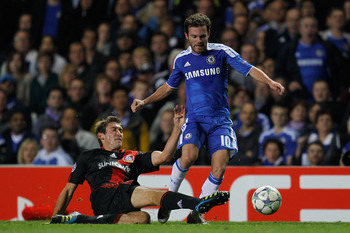 LONDON, ENGLAND - SEPTEMBER 13:  Stefan Reinartz of Bayer Leverkusen tackles Juan Mata of Chelsea during the UEFA Champions League Group E match between Chelsea and Bayer 04 Leverkusen at Stamford Bridge on September 13, 2011 in London, England.  (Photo b