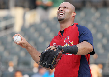 NEW YORK, NY - JULY 19:  Albert Pujols #5 of the St. Louis Cardinals has a laugh as he warms up prior to playing against the New York Mets at Citi Field on July 19, 2011 in the Flushing neighborhood of the Queens borough of New York City.  (Photo by Jim M