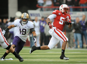 LINCOLN, NE - SEPTEMBER 17: Braylon Heard #5 of the Nebraska Cornhuskers runs past Gregory Ducre #18 of the Washington Huskies during their game at Memorial Stadium September 17, 2011 in Lincoln, Nebraska. Nebraska won 51-38.(Photo by Eric Francis/Getty I