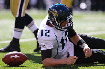 EAST RUTHERFORD, NJ - SEPTEMBER 18:  Luke McCown #12 of the Jacksonville Jaguars on the ground after being sacked against the New York Jets at MetLife Stadium Stadium on September 18, 2011 in East Rutherford, New Jersey.  (Photo by Nick Laham/Getty Images