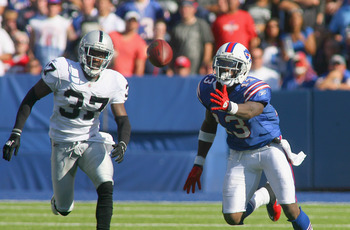 ORCHARD PARK, NY - SEPTEMBER 18:  Stevie Johnson #13 of the Buffalo Bills can't reach the ball for a catch against Chris Johnson #37 of the Oakland Raiders at Ralph Wilson Stadium on September 18, 2011 in Orchard Park, New York. Buffalo won 38-35.  (Photo