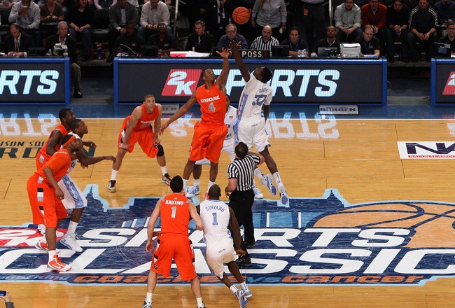 NEW YORK - NOVEMBER 20:  Ed Davis #32 of the North Carolina Tar Heels and Wes Johnson #4 of the Syracuse Orange take the opening tip during the championship game of the 2K Sports Classic on November 20, 2009 at Madison Square Garden in New York City.  (Ph