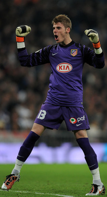 MADRID, SPAIN - JANUARY 13:  David De Gea of Atletico Madrid celebrates his sides opening goal during the quarter-final Copa del Rey first leg match between Real Madrid and Atletico Madrid at Estadio Santiago Bernabeu on January 13, 2011 in Madrid, Spain.
