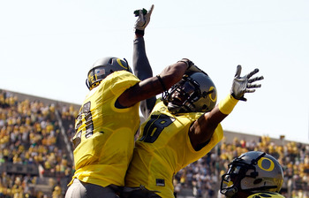 EUGENE, OR - SEPTEMBER 10:  LaMichael James #21 of the Oregon Ducks clelebrates with Anthony Gildon #18 after returning a punt for a touchdown against the Nevada Wolf Pack on September 10, 2011 at the Autzen Stadium in Eugene, Oregon.  (Photo by Jonathan 