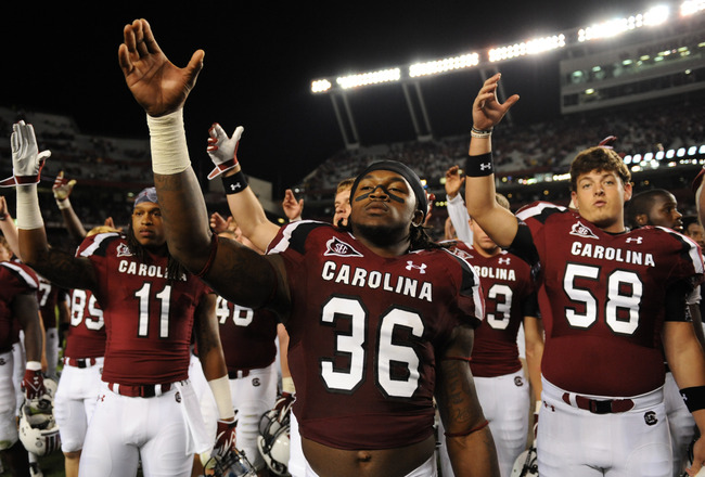 COLUMBIA, SC - SEPTEMBER 17:  Safety D.J. Swearinger #36 of the South Carolina Gamecocks salutes fans after play against the Navy Midshipmen September 17, 2011 at Williams-Brice Stadium in Columbia, South Carolina.  (Photo by Al Messerschmidt/Getty Images