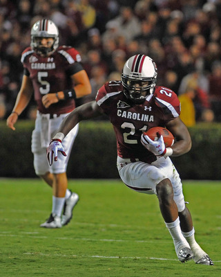 COLUMBIA, SC - SEPTEMBER 17:  Running back Marcus Lattimore #21 of the South Carolina Gamecocks rushes upfield against the Navy Midshipmen September 17, 2011 at Williams-Brice Stadium in Columbia, South Carolina.  Lattimore rushes for 247 yards and three