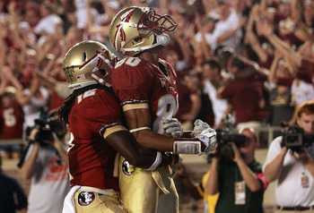 TALLAHASSEE, FL - SEPTEMBER 17:  Rashad Greene #80 of the Florida State Seminoles celebrates his touchdown pass reception with Jarred Haggins #12 against the Oklahoma Sooners in the fourth quarter at Doak Campbell Stadium on September 17, 2011 in Tallahas