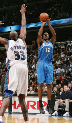 WAHINGTON - NOVEMBER 10:  Dwight Howard #12 of the Orlando Magic shoots against Brendan Haywood #33 of the Washington Wizards during the game on November 10, 2004 at the MCI Center in Washington D.C.  The Wizards won 106-96. NOTE TO USER:  User expressly