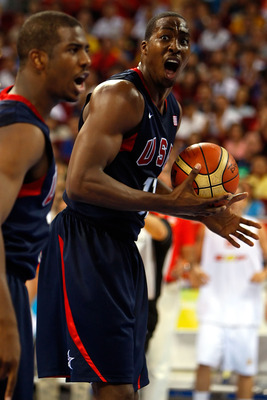 BEIJING - AUGUST 24:  Dwight Howard #11 and Chris Paul #13 of the United States react to a call in the gold medal game against Spain during Day 16 of the Beijing 2008 Olympic Games at the Beijing Olympic Basketball Gymnasium on August 24, 2008 in Beijing,