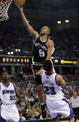SACRAMENTO, CA - MAY 5:  Tony Parker #9 of the San Antonio Spurs shoots over Kevin Martin #23 of he Sacramento Kings in game six of the Western Conference Quarterfinals during the 2006 NBA Playoffs on May 5, 2006 at ARCO Arena in Sacramento, California. T