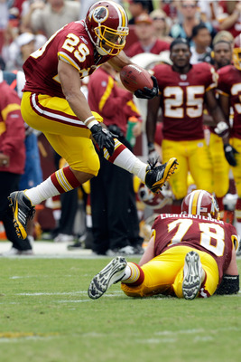 LANDOVER, MD - SEPTEMBER 18: Running back  Roy Helu #29 of the Washington Redskins jumps over teammate Kory Lichtensteiger #78 during the first half against the Arizona Cardinals at FedExField on September 18, 2011 in Landover, Maryland.  (Photo by Rob Ca