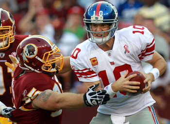 Chris Neild with Eli Manning in his grasp