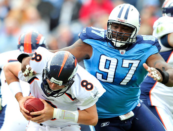 NASHVILLE, TN - OCTOBER 03:  Tony Brown #97 of the Tennessee Titans pressures quarterback Kyle Orton #8 of the Denver Broncos during the first half at LP Field on October 3, 2010 in Nashville, Tennessee.  (Photo by Grant Halverson/Getty Images)