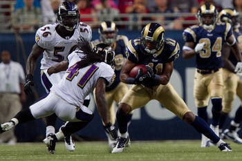 ST. LOUIS - SEPTEMBER 2: Brandon Gibson #11 of the St. Louis Rams looks to get past Travis Fisher #41 of the Baltimore Ravens during an NFL preseason game at the Edward Jones Dome on September 2, 2010 in St. Louis, Missouri.  (Photo by Dilip Vishwanat/Get