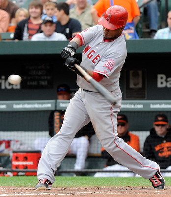 BALTIMORE, MD- SEPTEMBER 18:  Erick Aybar #2 of the Los Angeles Angels of Anaheim hits a solo home run in the third inning of a baseball game against the Baltimore Orioles at Oriole Park at Camden Yards on September 18, 2011 in Baltimore, Maryland. (Photo
