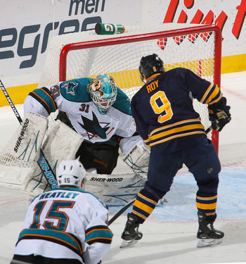 BUFFALO, NY - DECEMBER 09: Antti Niemi #31 of the San Jose Sharks makes a save on Derek Roy #9 of the Buffalo Sabres  at HSBC Arena on December 9, 2010 in Buffalo, New York.  (Photo by Rick Stewart/Getty Images)