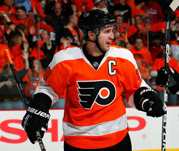 PHILADELPHIA, PA - APRIL 16:  Mike Richards #18 of the Philadelphia Flyers reacts after a Flyers goal in Game Two of the Eastern Conference Quarterfinals against the Buffalo Sabres during the 2011 NHL Stanley Cup Playoffs at Wells Fargo Center on April 16