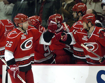 RALEIGH, NC - JANUARY 12:  Erik Cole #26 of the Carolina Hurricanes celebrates with teammates after scoring a goal against the Colorado Avalanche in the first period on January 12, 2008 at the RBC Center in Raleigh, North Carolina. (Photo By Grant Halvers