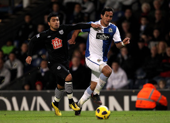 BLACKBURN, ENGLAND - JANUARY 23:  Roque Santa Cruz of Blackburn Rovers competes with Gonzalo Jara of West Bromwich Albion during the Barclays Premier League match between Blackburn Rovers and West Bromwich Albion at Ewood Park on January 23, 2011 in Black