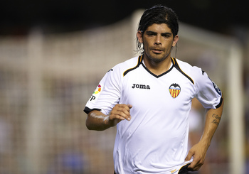 VALENCIA, SPAIN - AUGUST 27:  Ever Banega of Valencia looks on during the La Liga match between Valencia and Racing de Santander at Estadio Mestalla on August 27, 2011 in Valencia, Spain.  (Photo by Manuel Queimadelos Alonso/Getty Images)