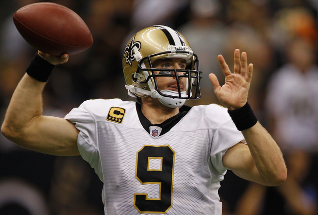NEW ORLEANS, LA - SEPTEMBER 18:  Drew Brees #9 of the New Orleans Saints looks to throw a pass against the Chicago Bears at Louisiana Superdome on September 18, 2011 in New Orleans, Louisiana.  The Saints defeated the Bears 30-13.  (Photo by Chris Graythe