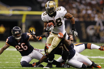 NEW ORLEANS, LA - SEPTEMBER 18:  Mark Ingram #28 of the New Orleans Saints is tackled by  Brandon Meriweather #31 of the Chicago Bears at Louisiana Superdome on September 18, 2011 in New Orleans, Louisiana.  The Saints defeated the Bears 30-13.  (Photo by