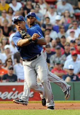 BOSTON, MA - SEPTEMBER 03: Adrian Beltre #29 of the Texas Rangers throws to first base in the first inning against the Boston Red Sox at Fenway Park on September 3, 2011 in Boston, Massachusetts. The Boston Red Sox won the game 12-7. (Photo by Darren McCo