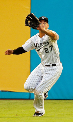 MIAMI GARDENS, FL - AUGUST 23:  Mike Stanton #27 of the Florida Marlins makes a catch during a game agains the Cincinnati Reds at Sun Life Stadium on August 23, 2011 in Miami Gardens, Florida.  (Photo by Mike Ehrmann/Getty Images)