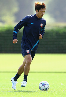 ST ALBANS, ENGLAND - SEPTEMBER 12:  Ju Young Park of Arsenal dribbles with the ball during a training session ahead of their UEFA Champions League Group match against Borussia Dortmund at London Colney on September 12, 2011 in St Albans, England. (Photo b