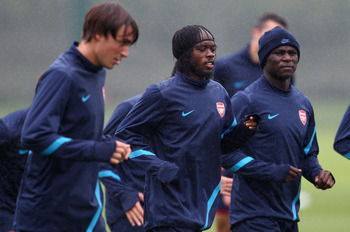 ST ALBANS, ENGLAND - AUGUST 23:  Gervinho (C) with Emmanuel Frimpong (R) and Ignasi Miquel of Arsenal during a training session ahead of their UEFA Champions League Qualifying second leg match against Udinese at London Colney on August 23, 2011 in St Alba