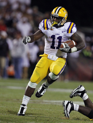 STARKVILLE, MS - SEPTEMBER 15:  Running back Spencer Ware #11 of the LSU Tigers runs for a first down against the Mississippi State Bulldogs on September 15, 2011 at Davis Wade Stadium in Starkville, Mississippi. (Photo by Butch Dill/Getty Images)