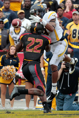 COLLEGE PARK, MD - SEPTEMBER 17: Defensive back Cameron Chism #22 of the Maryland Terrapins breaks up a pass in the endzone intended for wide receiver Stedman Bailey #3 of the West Virginia Mountaineers during the second half at Byrd Stadium on September