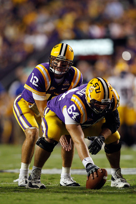 BATON ROUGE, LA - OCTOBER 16:  Jarrett Lee #12 waits for the ball to be snapped by P.J. Lonergan #64 of the Louisiana State University Tigers during the game against  the McNeese State Cowboys at Tiger Stadium on October 16, 2010 in Baton Rouge, Louisiana