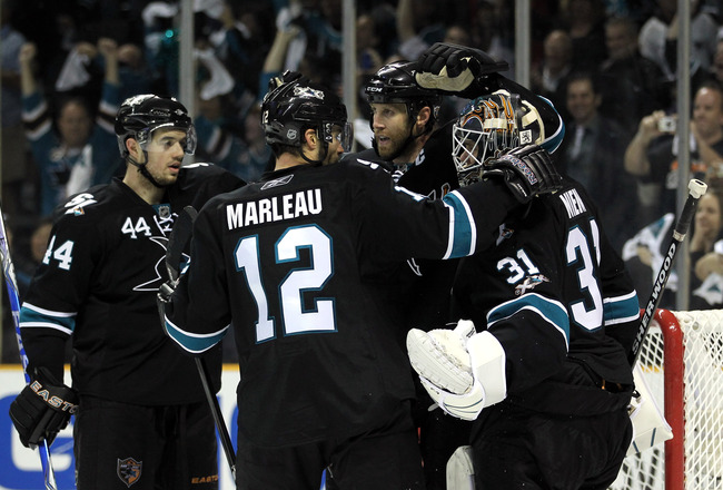 SAN JOSE, CA - MAY 01:  Joe Thornton #19, Patrick Marleau #12 and Marc-Edouard Vlasic #44 congratulates Antti Niemi #31 of the San Jose Sharks after they beat the Detroit Red Wings in Game Two of the Western Conference Semifinals during the 2011 NHL Stanl