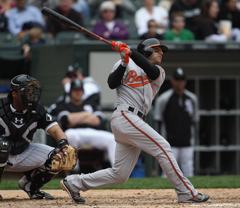 CHICAGO, IL - MAY 01: Brian Roberts #1 of the Baltimore Orioles hits the ball against the Chicago White Sox at U.S. Cellular Field on May 1, 2011 in Chicago, Illinois. The Orioles defeated the White Sox 6-4. (Photo by Jonathan Daniel/Getty Images)