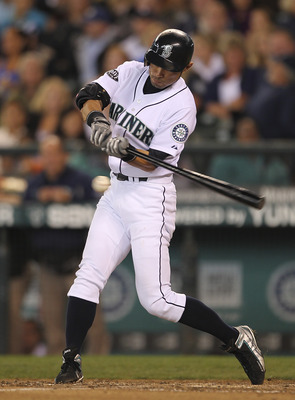 SEATTLE - SEPTEMBER 18:  Ichiro Suzuki #51 of the Seattle Mariners singles in the seventh inning against the Texas Rangers at Safeco Field on September 18, 2011 in Seattle, Washington. (Photo by Otto Greule Jr/Getty Images)