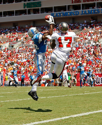 Detroit Lions cornerback Chris Houston makes a leaping interception over Tampa Bay Buccaneers wide receiver Arrelious Benn.