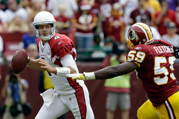 LANDOVER, MD - SEPTEMBER 18: Quarterback  Kevin Kolb #4 of the Arizona Cardinals rolls out to pass while being pressured by defender  London Fletcher #59 of the Washington Redskins during the second half at FedExField on September 18, 2011 in Landover, Ma