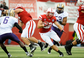 LINCOLN, NE - SEPTEMBER 17: Rex Burkhead #22 of the Nebraska Cornhuskers finds an opening in the Washington Huskies defense during their game at Memorial Stadium September 17, 2011 in Lincoln, Nebraska. Nebraska won 51-38.(Photo by Eric Francis/Getty Imag