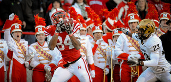 LINCOLN, NE - NOVEMBER 26: Brandon Kinnie #84 of the Nebraska Cornhuskers catches a touchdown over Jalil Brown #23 of the Colorado Buffaloes during the first half of their game at Memorial Stadium on November 26, 2010 in Lincoln, Nebraska.  Nebraska defea