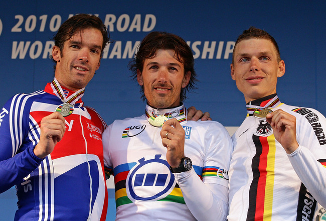 GEELONG, AUSTRALIA - SEPTEMBER 30:  David Millar of Great Britain, Fabian Cancellara of Switzerland and Tony Martin of Germany hold their medals aloft during the medal presentation for the Men's Elite Time Trial on day two of the UCI Road World Championsh
